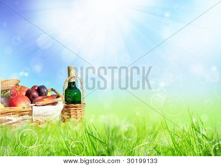 Beautiful spring scenery with picnic in meadow