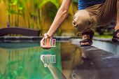 Pool Worker Checks The Pool For Safety. Measurement Of Chlorine And Ph Of A Pool poster