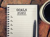 New Year Goal Concept - Goals 2020 Written On A Notebook. poster