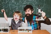 Back To School. Elementary School Teacher And Student In Classroom. Home Schooling. Father Teaching  poster