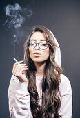 Cancer Cures Smoking. Pretty Woman With Long Hair Smoking Cigarette. Sensual Smoking Addict Or Smoke poster