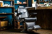 Stylish Vintage Barber Chair. Barbershop Theme. Professional Hairstylist In Barbershop Interior. Bar poster