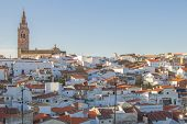 Jerez De Los Caballeros Townscape From Templar Fortress Viewpoint. Church Of San Bartolome Tower At  poster