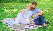 Family Enjoy Relax Nature Background. Couple Bearded Man And Blonde Woman Relax Nature While Sit On  poster