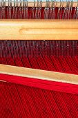 pic of handloom  - Close up shot of loom with red thread - JPG