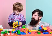 Little Boy With Bearded Man Dad Playing Together. Child Development. Happy Family. Leisure Time. Bui poster