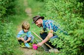 Little Helper In Garden. Farm Family. Little Boy And Father In Nature Background. Gardening Tools. G poster