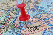 pic of united states map  - Close up of map of New York with push pin on city - JPG