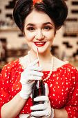 Pin up girl drinking popular carbonated drink poster