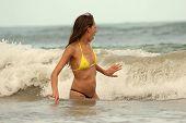 Girl Swimming In Ocean