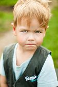 A Handsome Angry Boy Looks At You. The Child Is Upset By The Conflict Or Quarrel. The Boy Is Angry A poster