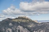 An Aerial View Of Black Elk Peak ( Formerly Harney Peak) And Tower Which Overlooks Eroded Rock Forma poster