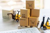 Mini Forklift Truck Load Stack Of Cardboard Boxes With Text Online Shopping And Symbols On Wooden Pa poster