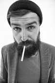Man Brutal Bearded Hipster Smoking Cigarette. Brutal Habits And Lifestyle. Hipster Brutal Bearded To poster