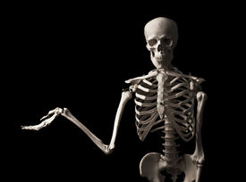 stock photo of emaciated  - Human skeleton with an outstretched hand isolated on black background - JPG