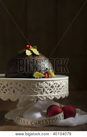 Christmas pudding on comport with ribbon and baubles