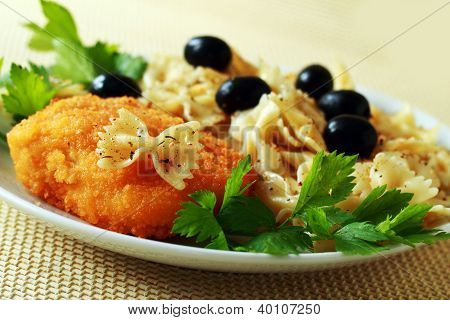 Ukrainian Chicken Chop Of Kiev And Pasta With Olives Ready To The Meal