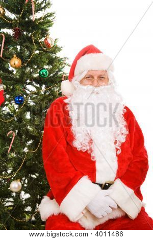 Santa Sitting Under Christmas Tree