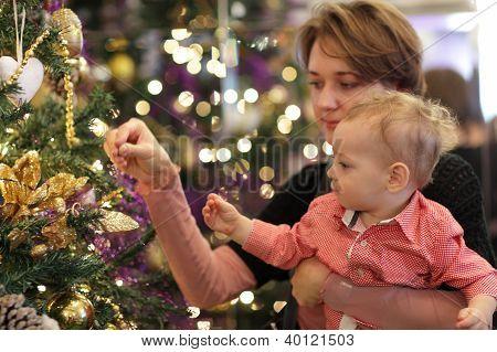 Family Dressing Christmas Tree