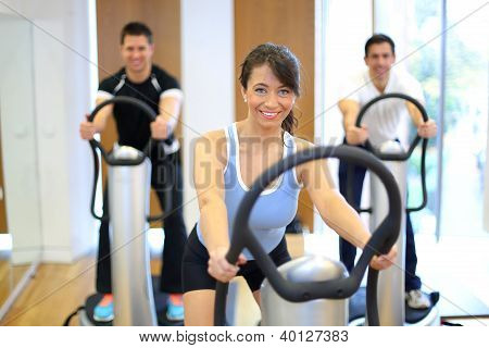 Woman On Vibration Plate In A Gym