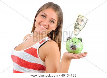 Isolated young casual woman with piggybank