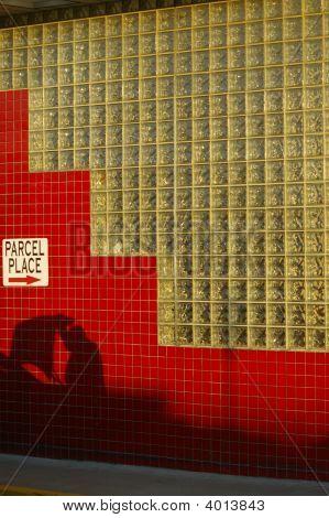 Shadow Of Man Bagging Groceries