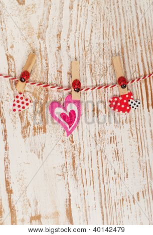Hearts Hanging On A Rope With Pins