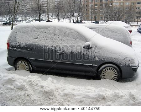 Snow Covered Car In The Snowdrift After Cyclone