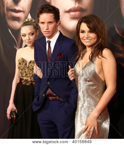 NEW YORK- DEC 10: Amanda Seyfriend, Eddie Redmayne and Samantha Banks attend the premiere of
