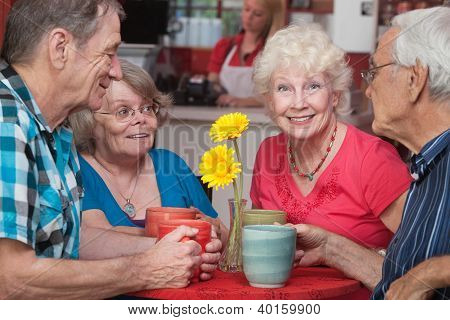 Happy Seniors At Restaurant