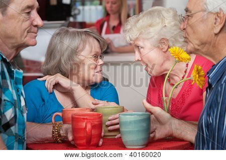 Senior Couples Chatting In Cafe
