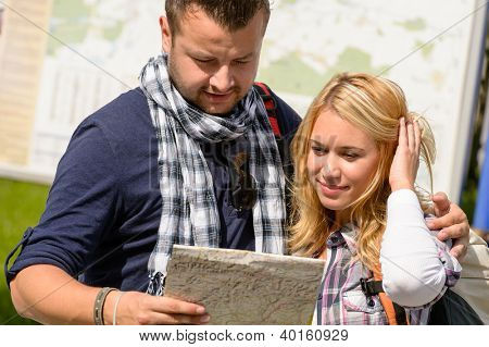 Couple looking at map on city break vacation leisure togetherness