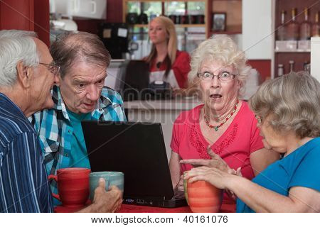 Shocked Seniors With Laptop