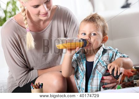 Mother watching son play with toys