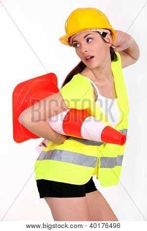 Sexy woman with traffic cones
