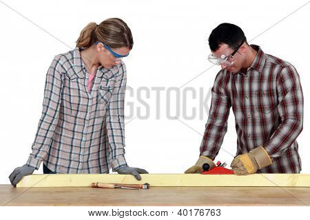 craftswoman and craftsman working together