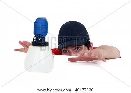 Manual worker reaching for a sprayer