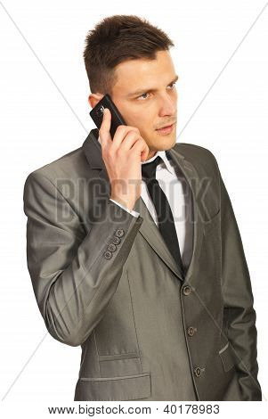 Serious Business Man Calling By Phone