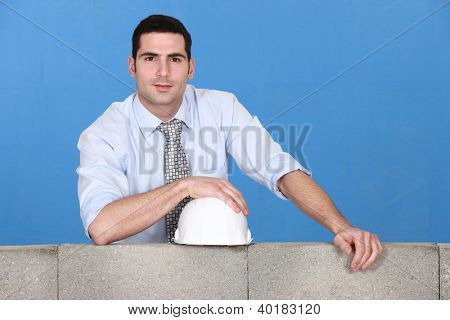 Engineer standing by wall