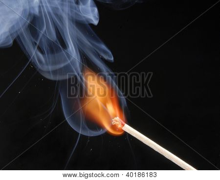 lighting a match on black background.
