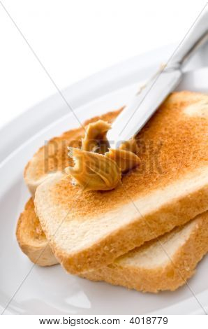 Spreading Peanut Butter On Toast