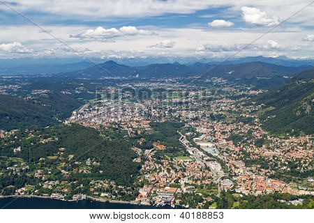 Lake Como in Italy with view to the town of Cernobbio and the swiss alps