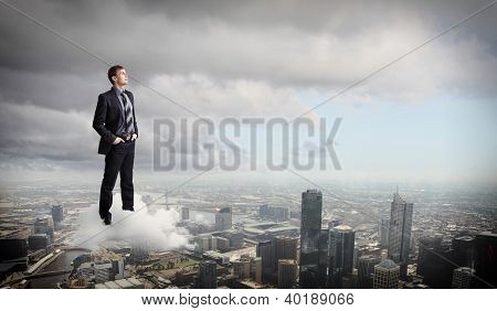 Businessman against cityscape