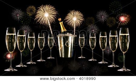 Glasses Of Champagne With Silver Ice Bucket With Fireworks
