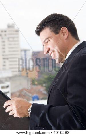 Businessmann Reading An Inform