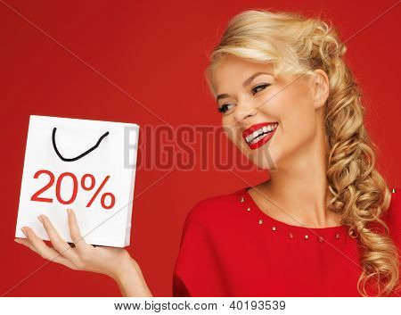 picture of lovely woman in red dress with shopping bag