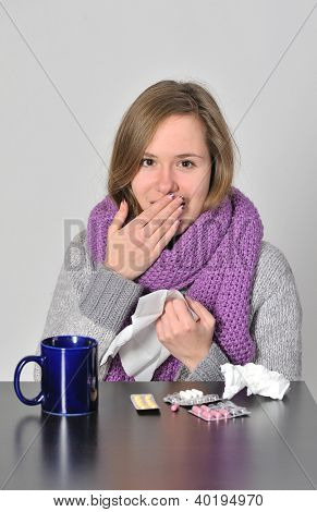 having flu young girl takes her  medicine for cold