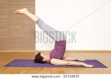 An image of a pretty woman doing yoga
