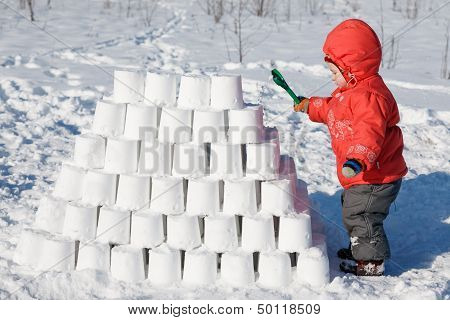Kid Building A Snow Castle