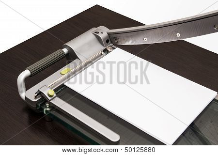 Sheet Of Paper In The Guillotine